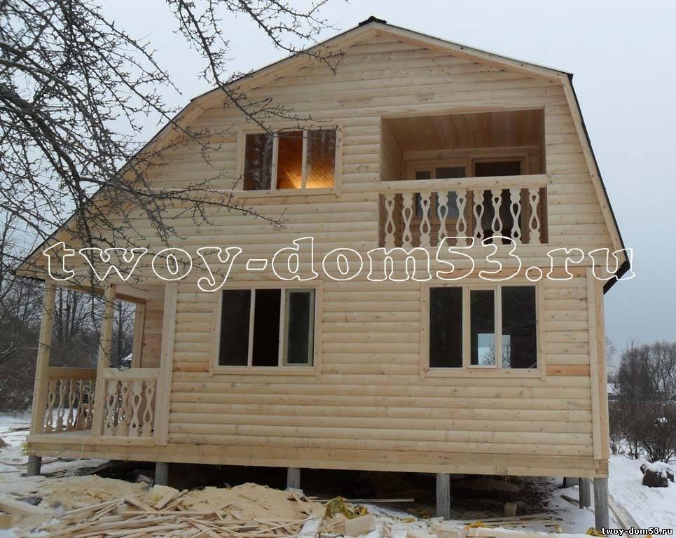 Дом из бруса 8*8 с балконом и террасой.